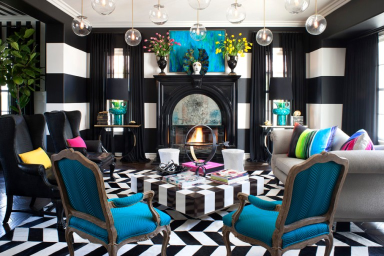 modern-bohemian-living-room-decorating-ideas-with-bulb-chandelier-combining-white-sofa-and-two-black-leather-armless-chair-and-black-and-white-stripe-floor-909x606