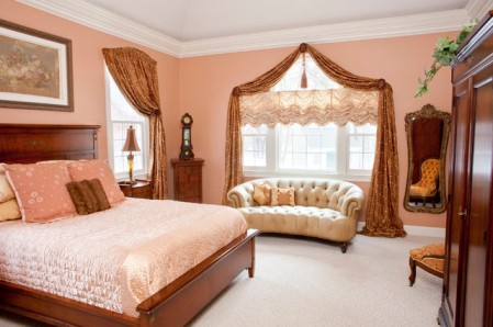 Extraordinary-Peach-Themed-Bedroom-Ideas-with-Wooden-Bed-for-Couple-Tufted-Sofa-Wardrobe-and-Chair