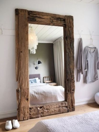Mirror framed with reclaimed wood